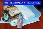 Administratorul unei firme de transport internaţional, soţia acestuia şi un şofer, reţinuţi pentru trafic de droguri de mare risc