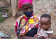 Imagini sfâșietoare din Kenya: O femeie gătește pietre. Copiii ei așteaptă masa...