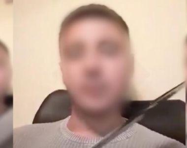 VIDEO | Şi-a ameninţat profesorul cu maceta